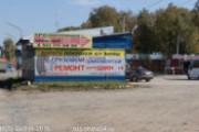 Грузовая шиномонтажная мастерская и магазин шин и дисков RUS-Шина по адресу ул.Зеленодолинская 1/1 корупус 2. Вид по дороге из города.